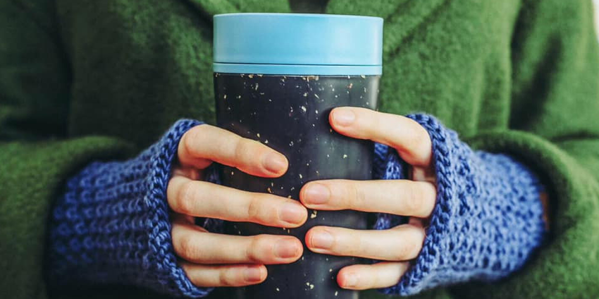 Person-holding-Circular-&-Co-coffee-cup-that-is made-within-the-circular-economy